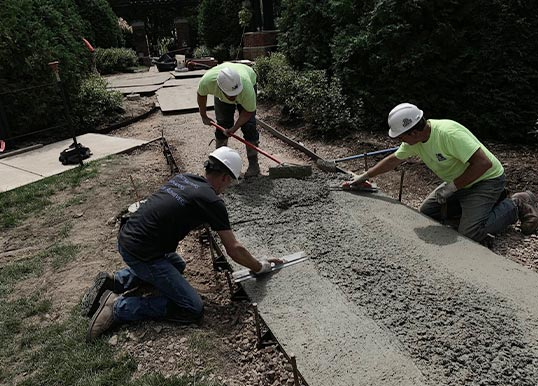spreading_cement_for_walkway